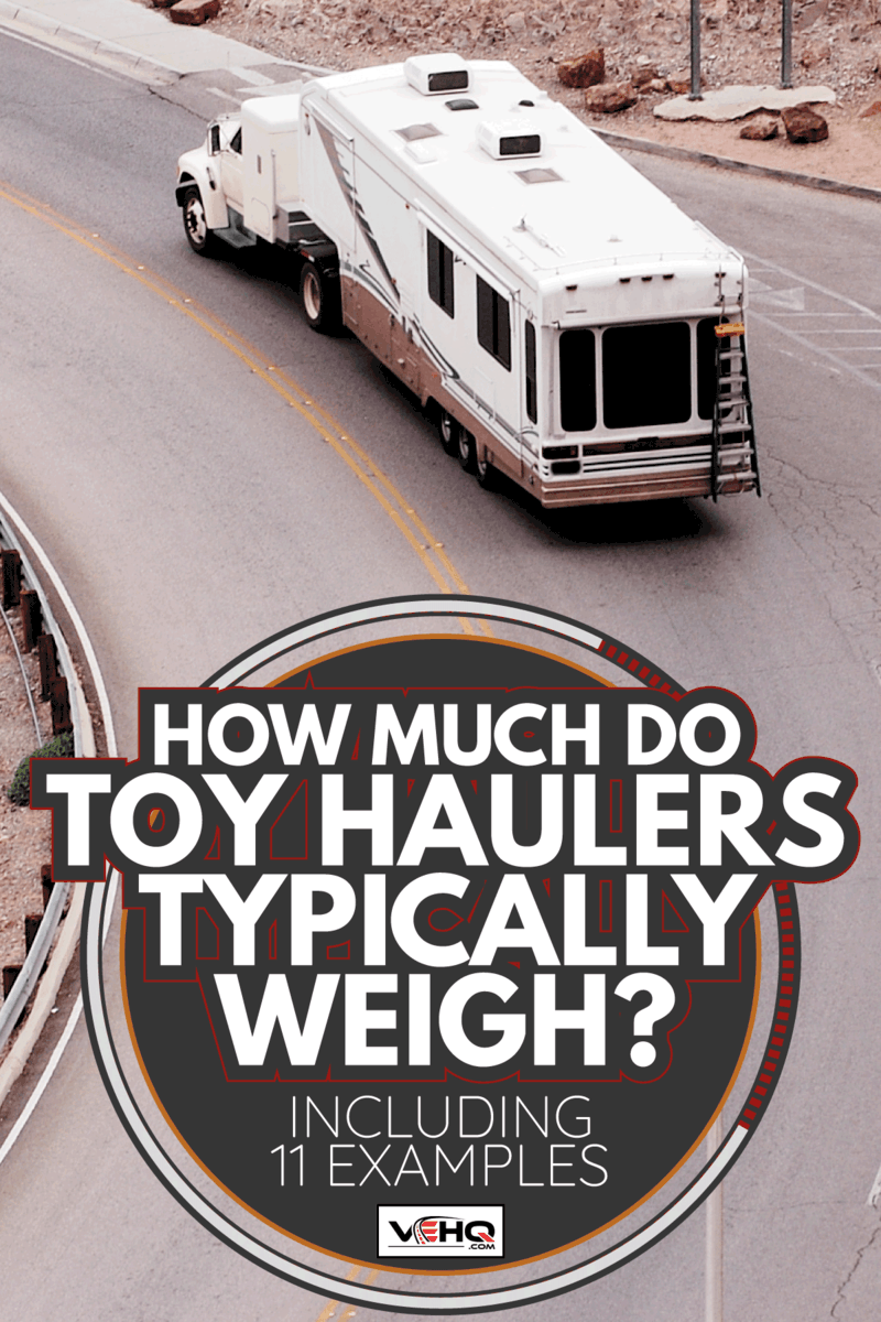 fifth wheel toy hauler being driven by a mover along a winding road. How Much Do Toy Haulers Typically Weigh [Including 11 Examples]