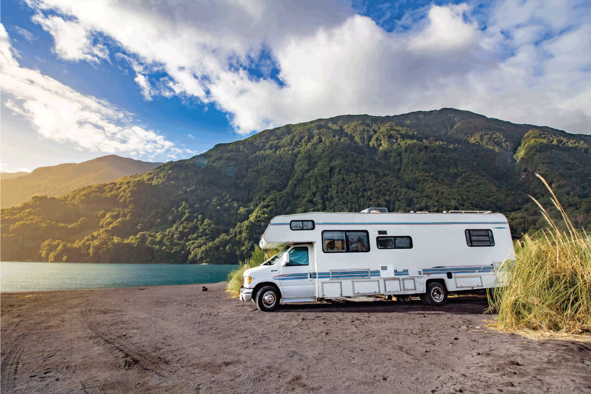 luxury RV motorhome with a picturesque mountain background view. RV Inverter Not Working - What To Do