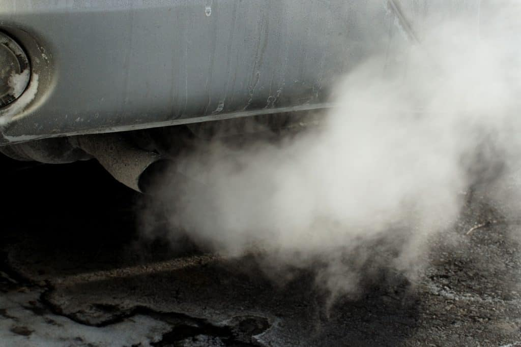 A cars exhaust excreting smoke