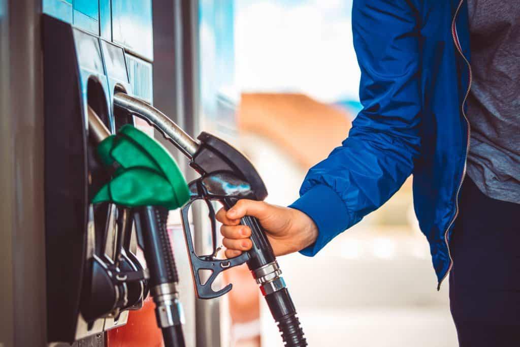A man holding a gasoline pump