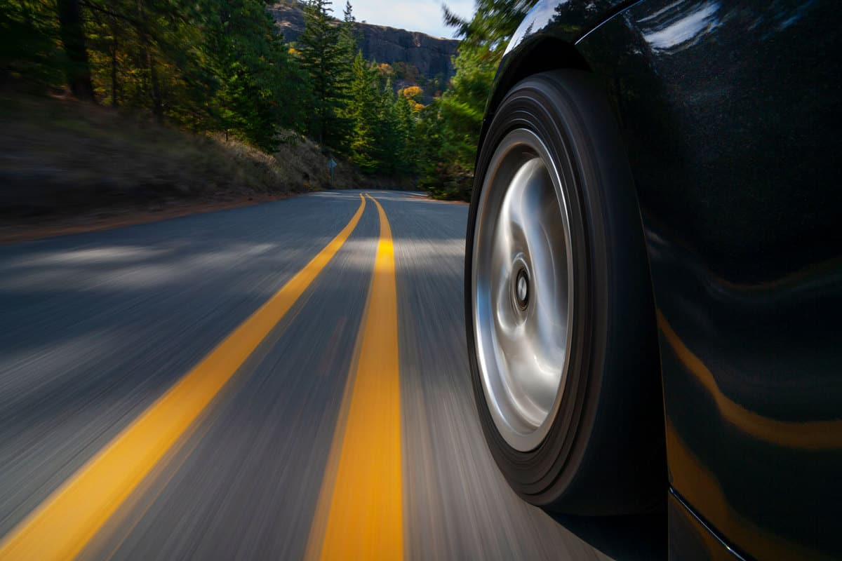 Black sports car motion country road, Do Tires Affect Acceleration, Speed, And Performance?