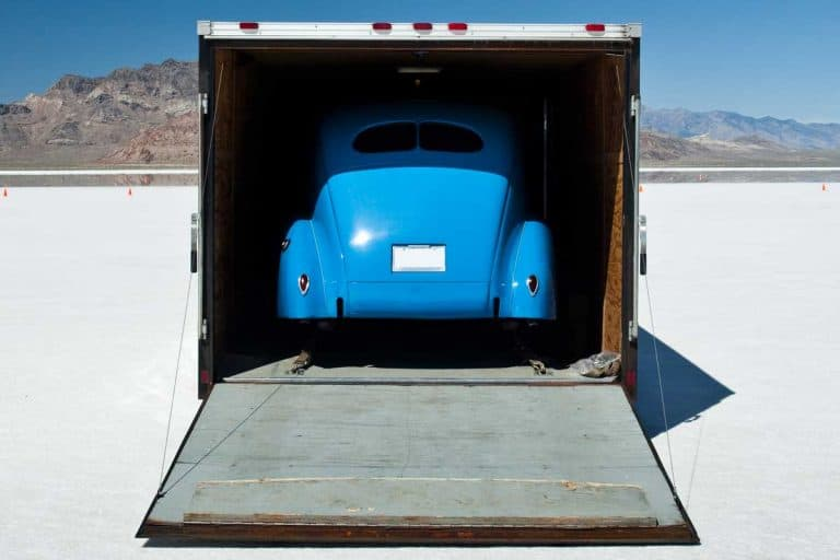 Blue car on the flats in toy hauler, How Much Weight Can A Toy Hauler Ramp Hold?