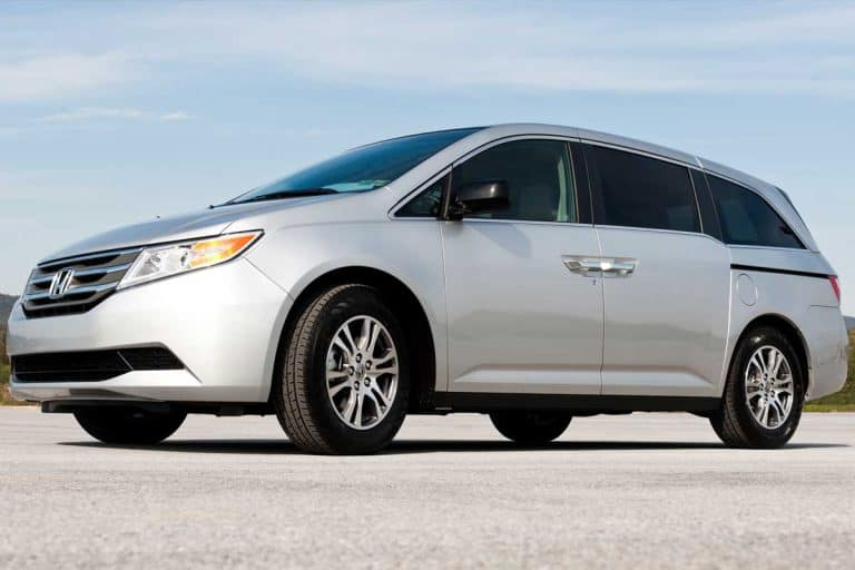 Brand new Honda Odyssey minivan in large parking lot on a sunny day, Honda Odyssey Not Recognizing Key - What To Do?