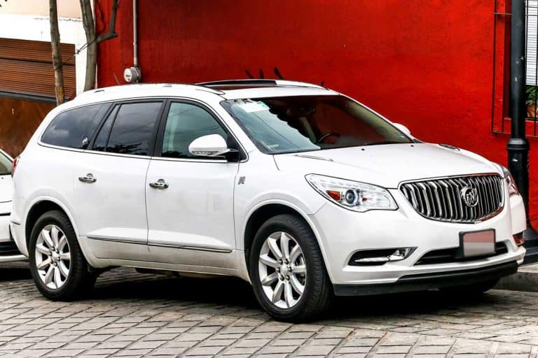 Car Buick Enclave in the city street, Does The Buick Enclave Have 3 Rows?