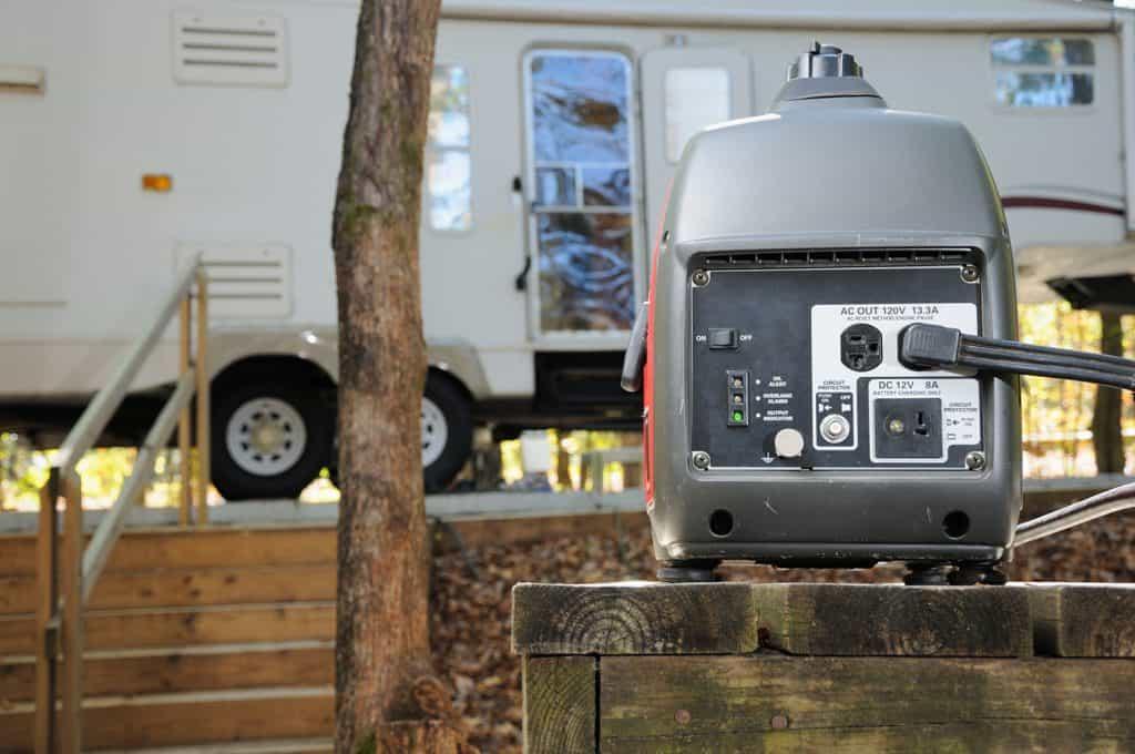 Close up of portable gasoline generator providing power for RV trailer