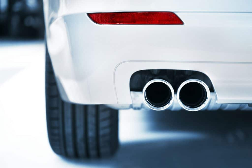 Close up photo of an exhaust and red light, Do Exhausts Get Louder Or Quieter Over Time?