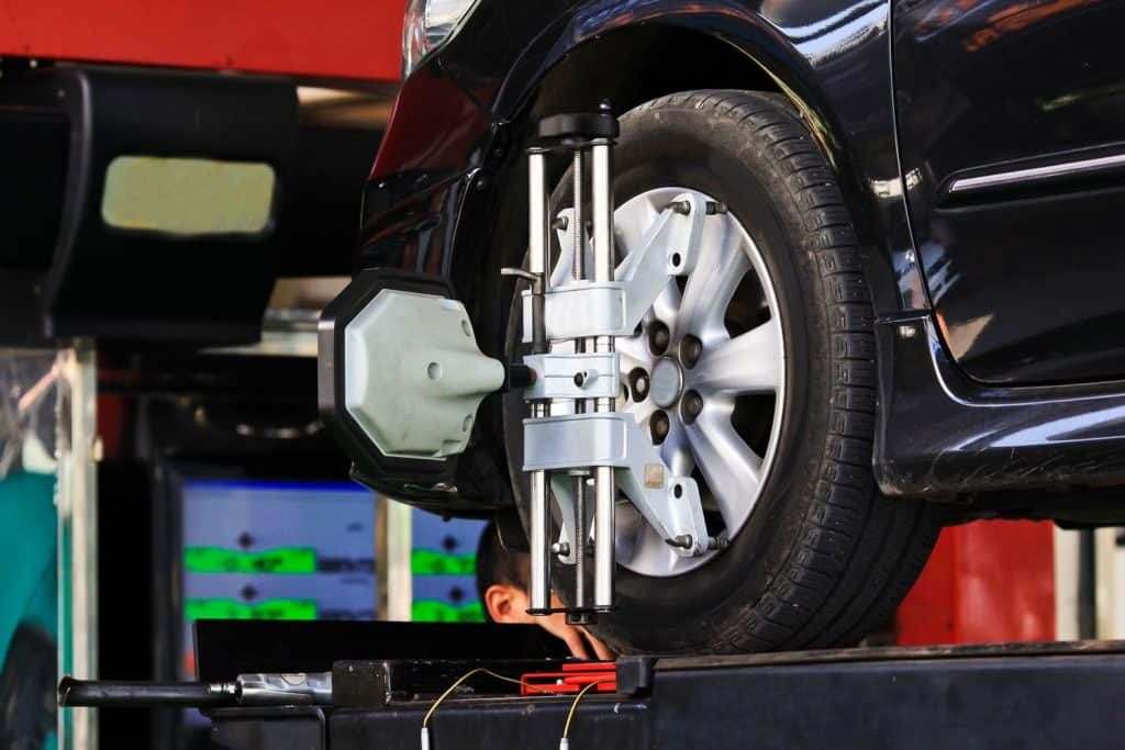 Computerized car tire alignment using a mechanical clamp