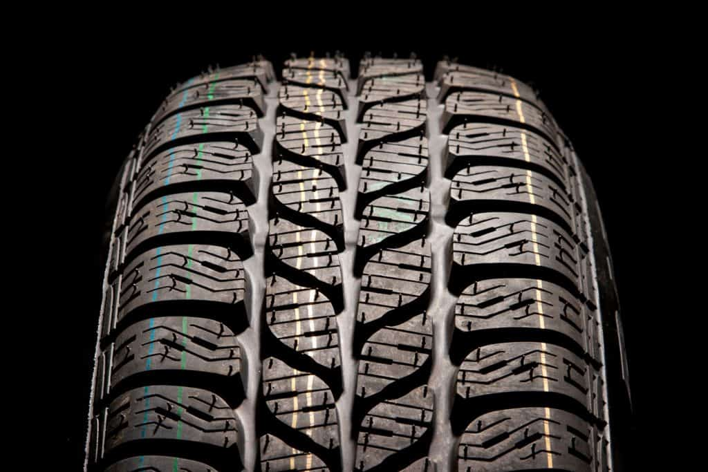 Detailed car tire treads on a black background, Do Tires On A New Car Typically Have A Warranty?