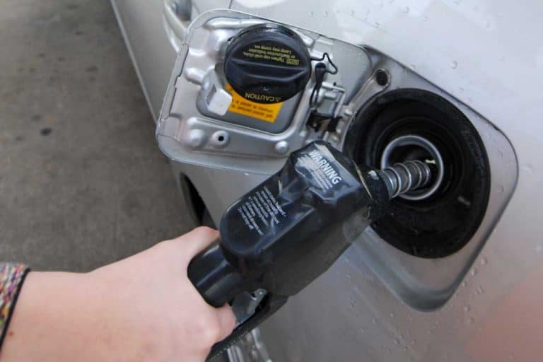 Filling the gas tank of a vehicle, What Are Fuel Tanks Made Of? [Everything You Need To Know!]