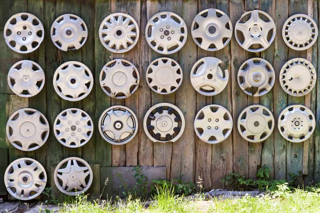 Lost car hubcaps hanged on the fence