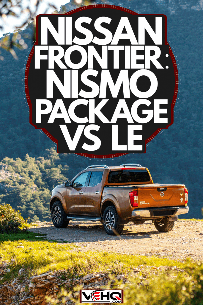 A brown Nissan Frontier parked near a cliff overviewing a gorgeous panoramic view of the mountains and landscape, Nissan Frontier: NISMO Package Vs LE