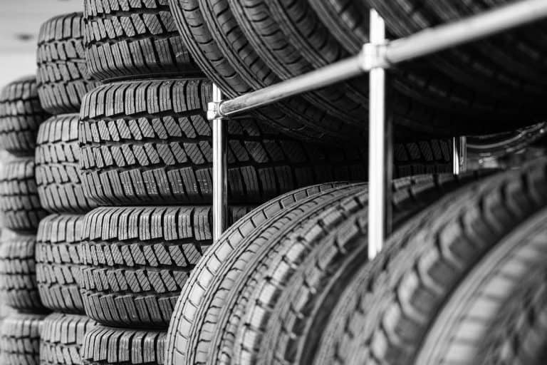 Rack with variety of new car tires in automobile store, How Wide Are Tires On Average? [By Type Of Vehicle]