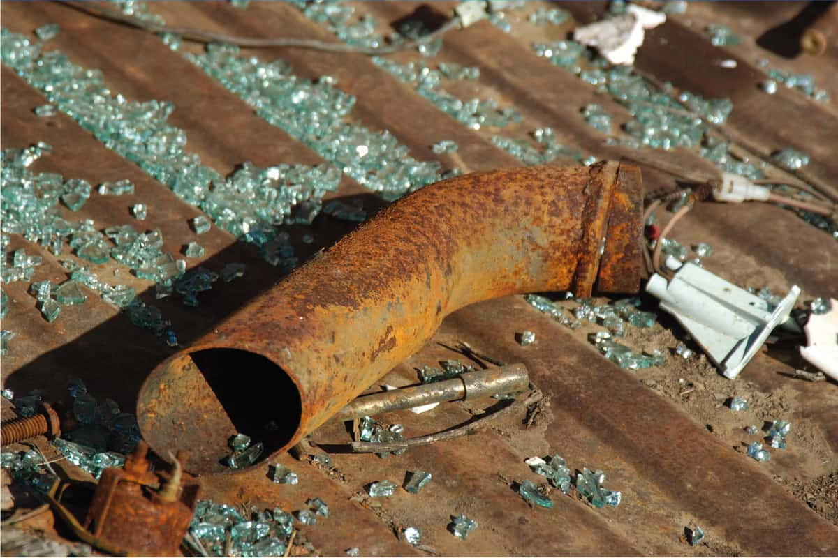 Rusted tailpipe in bed of junkyard wreck. How Long Should An Exhaust Pipe Last