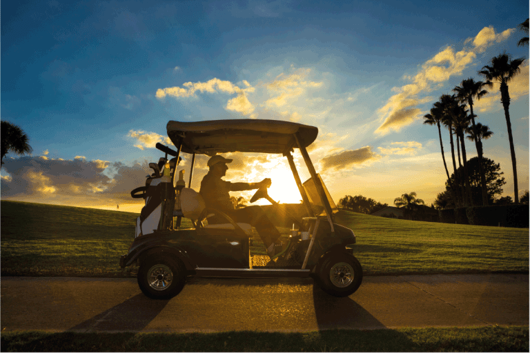 Senior man on golf course driving golf cart at sunrise. What Year Is My Yamaha Golf Cart
