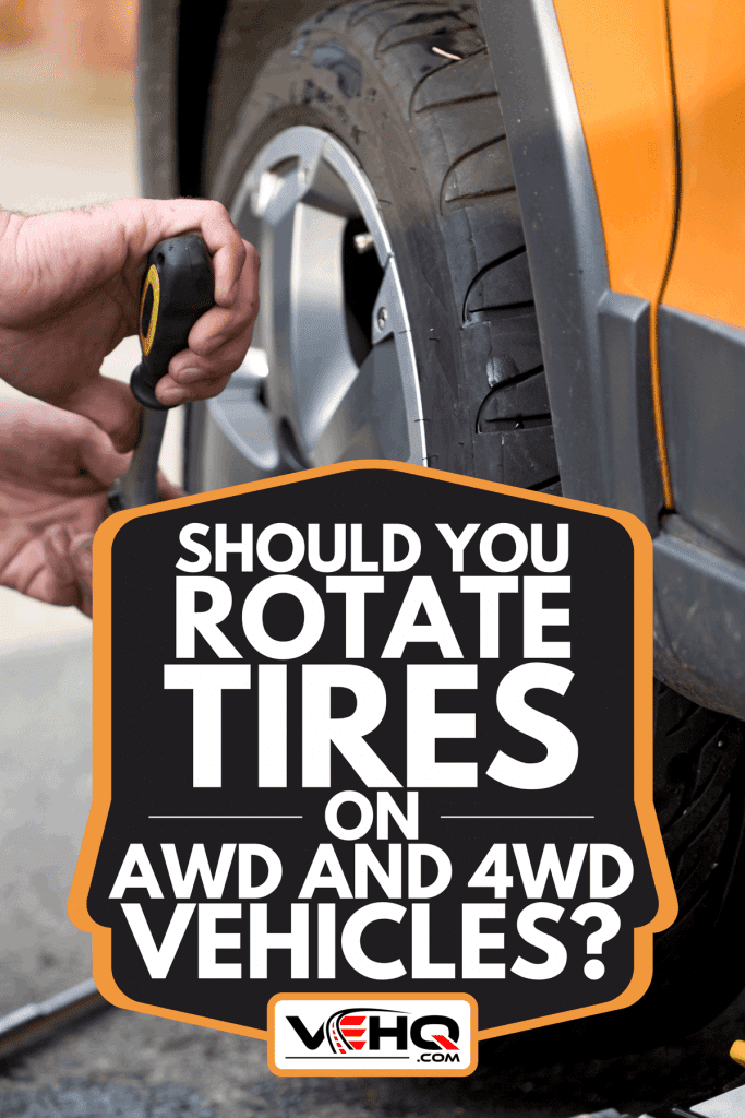 Man changing wheel of a car, Should You Rotate Tires On AWD And 4WD Vehicles?