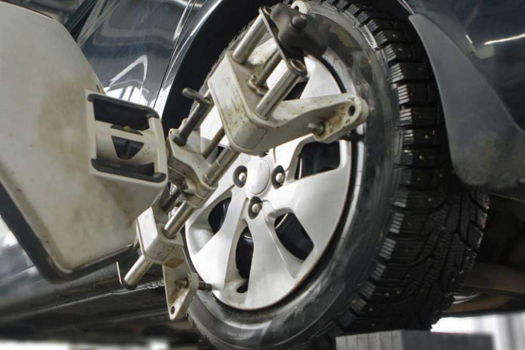 Technicians checking car wheels, Do Tires Need to Be Balanced When Rotated?