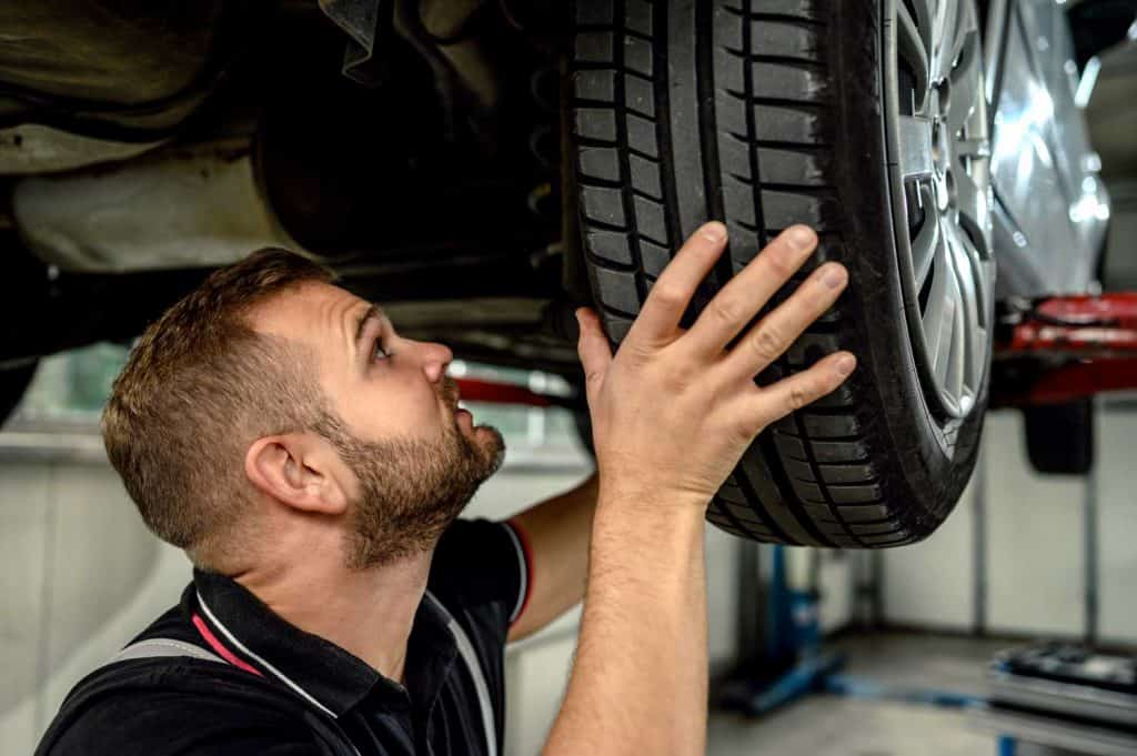 Tire changing at car service, Should You Rotate Tires On AWD And 4WD Vehicles?