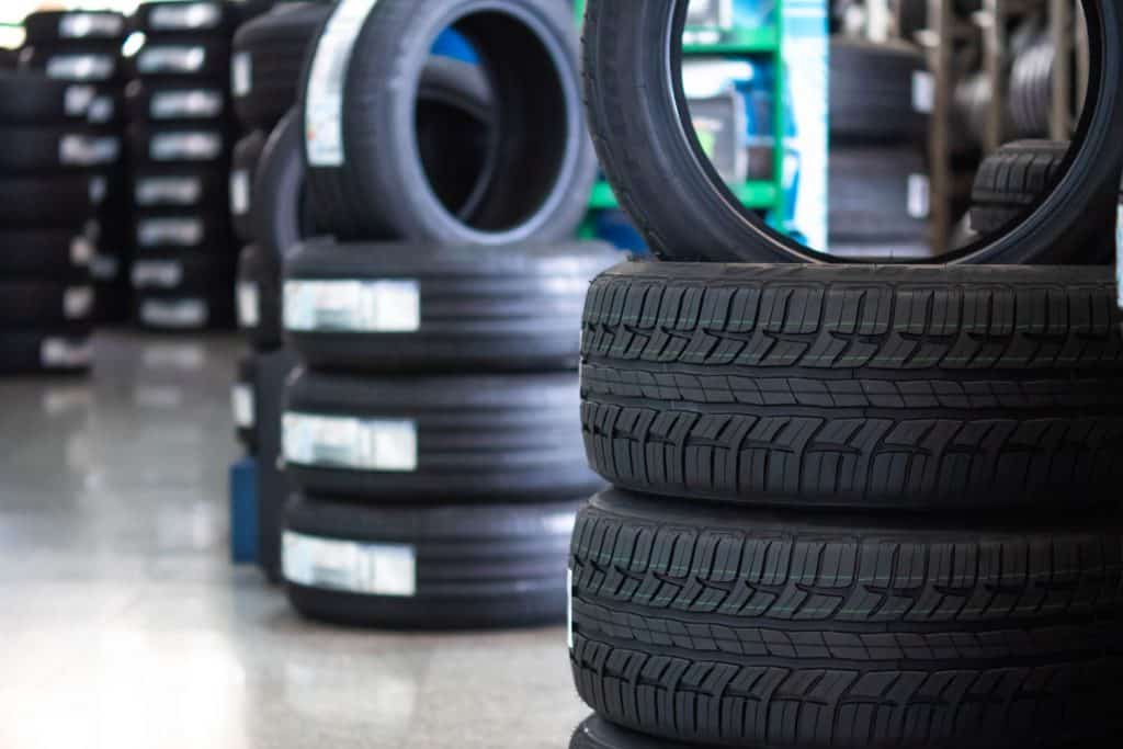 Tires of stacked on top of each other for display at a car shop