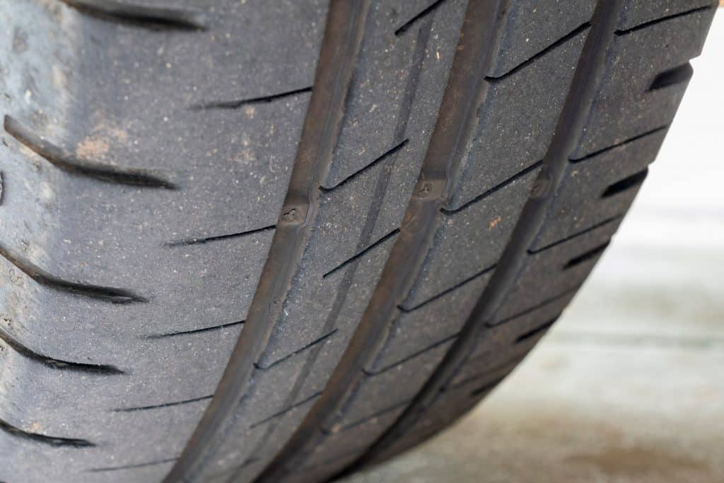Used car tire with tread wear indicator (TWI)