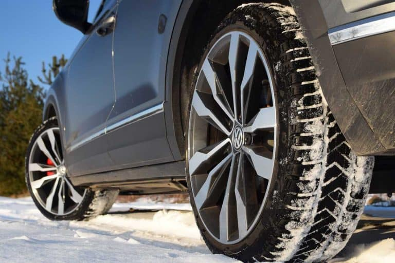Winter tires in modern car on the snowy road, Do All 4 Tires Need To Be The Same Brand? Or Can You Mix And Match?
