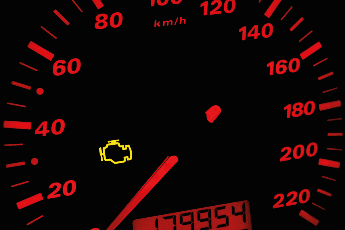 car instrument panel with check engine light on