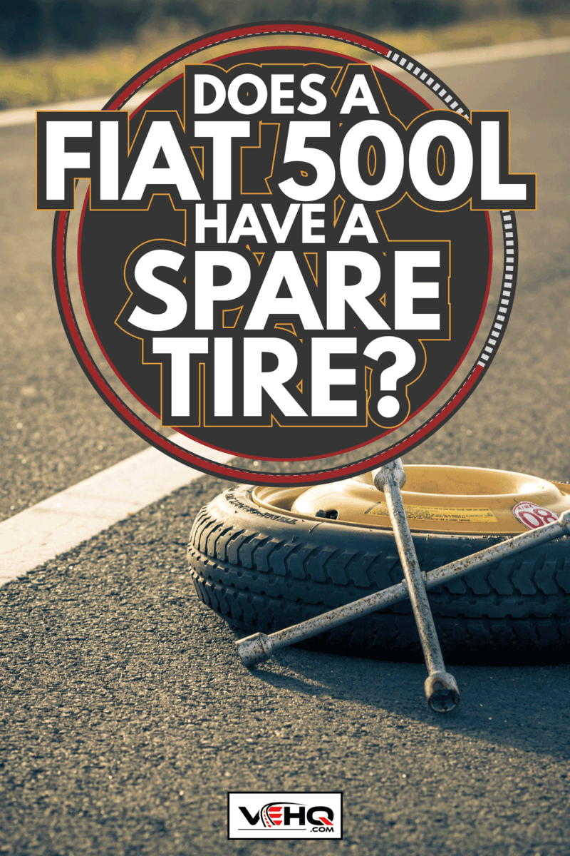 spare wheel of a car and a tire wrench on the asphalt. Does A Fiat 500L Have A Spare Tire